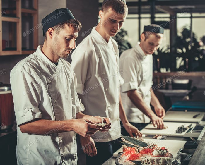 Preparing sushi set in restaurant kitchen