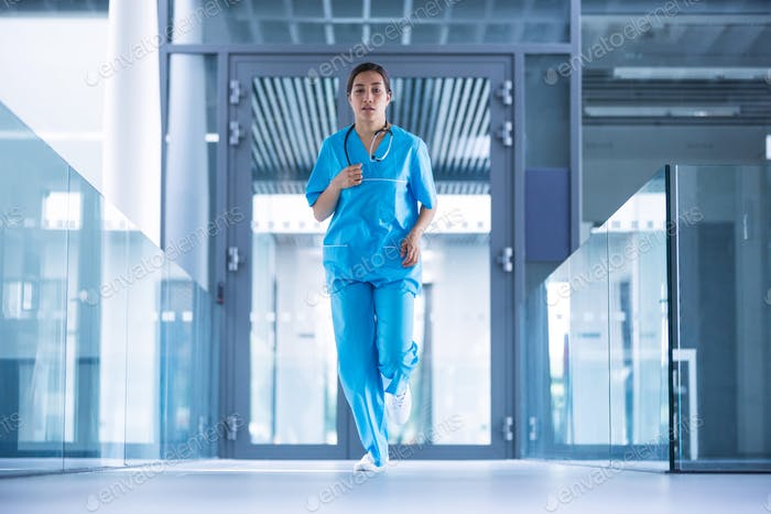 Nurse running in hospital corridor