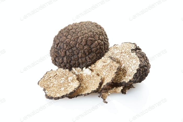 Black truffle and slices on white, clipping path