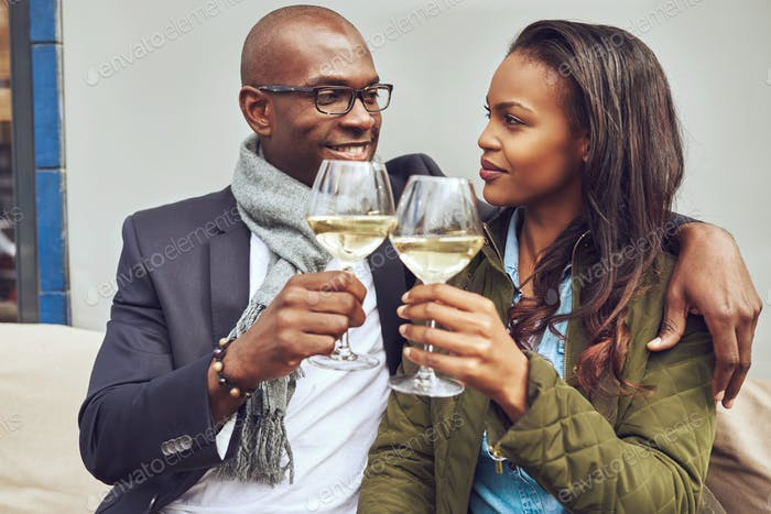 Romantic young couple share a toast
