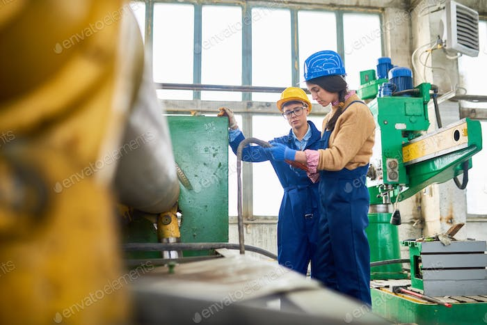 Modern women working on machine