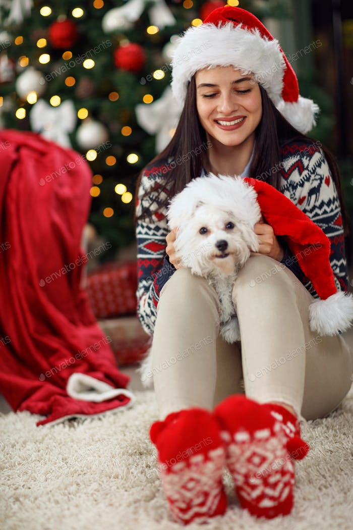 girl holding a Christmas present puppy dog