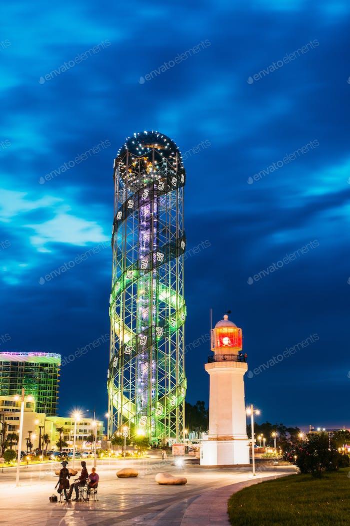 Batumi, Adjara, Georgia. Illuminated Alphabet Tower And Lighthou