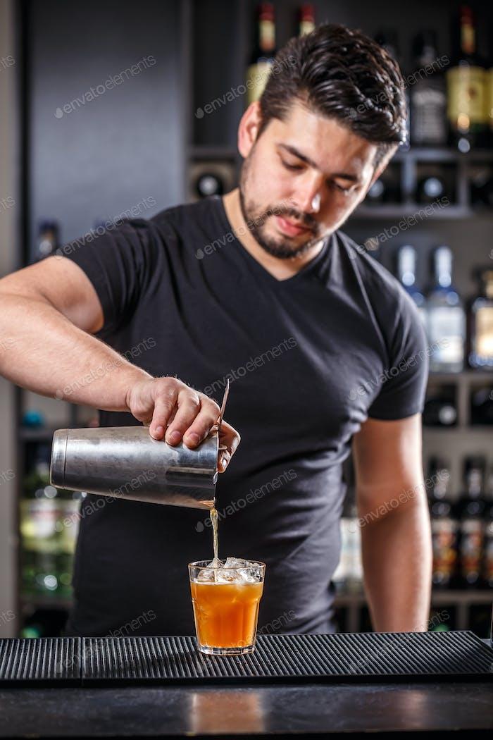 Barman pouring alcohol