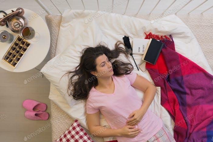 Sad spinster in bed
