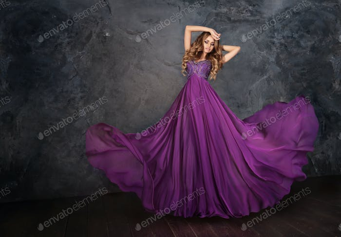A woman in a violet dress.