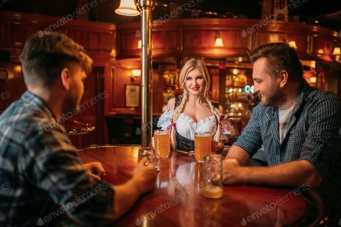 Surprised drunk man stairs at breasts of waitress