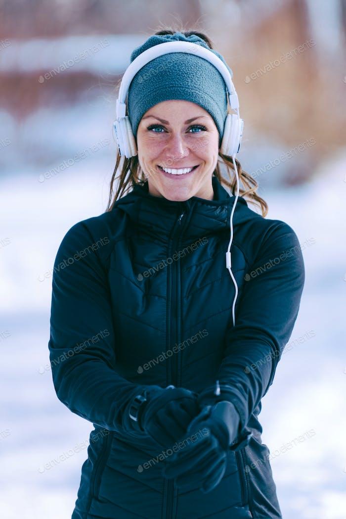 Female athlete jogging in park in winter
