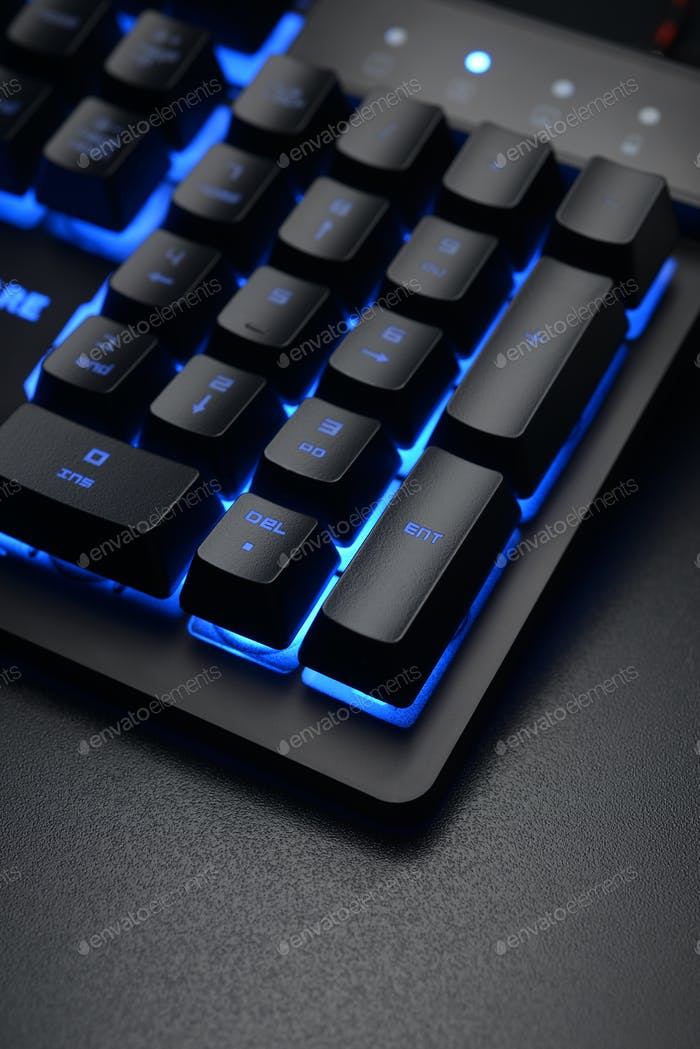 Black keyboard on the dark office desk