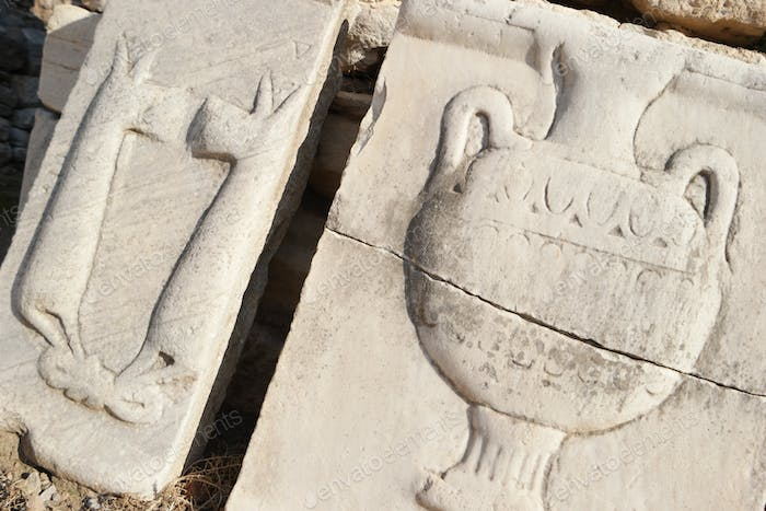 Archaeological remains of antiquity. Marble frieze panel in Ephesus.
