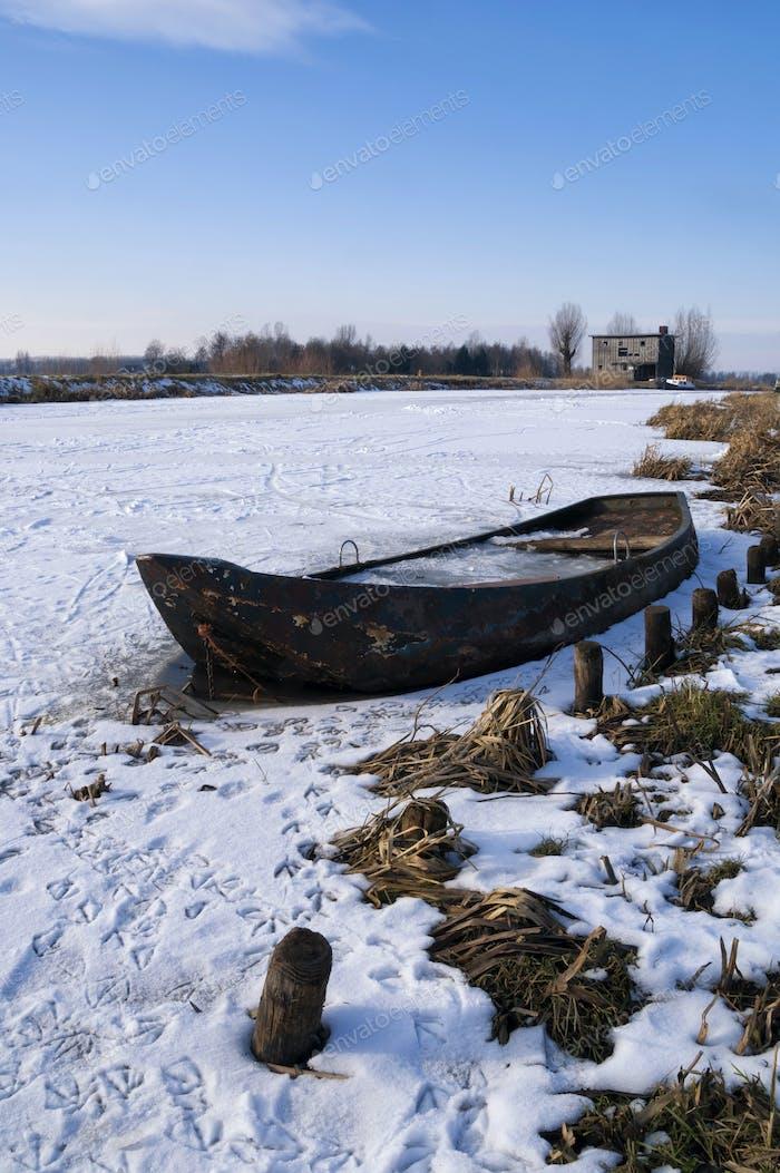 Rowing boat in a frozen river