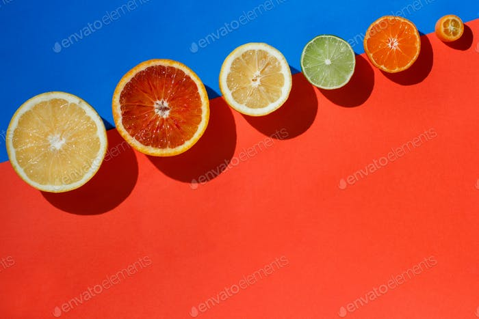 Citrus fruits on a red, yellow and blue background
