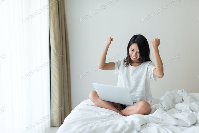 Excited Woman use of laptop computer
