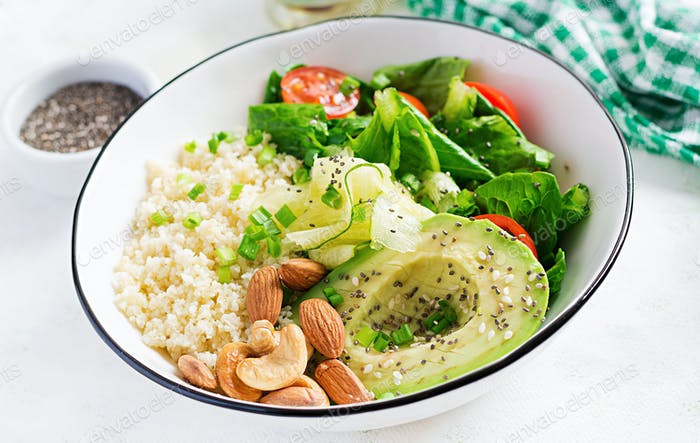 Vegan Buddha bowl with bulgur, avocado, cucumber, lettuce, tomatoes