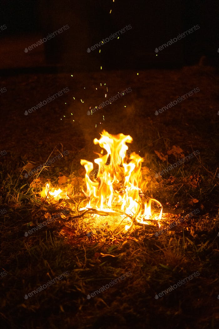 Small campfire in the middle of the field