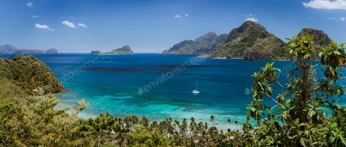 Coastal scenery from the mainland Palawan with tropical islands on horizon. El Nido-Philippines