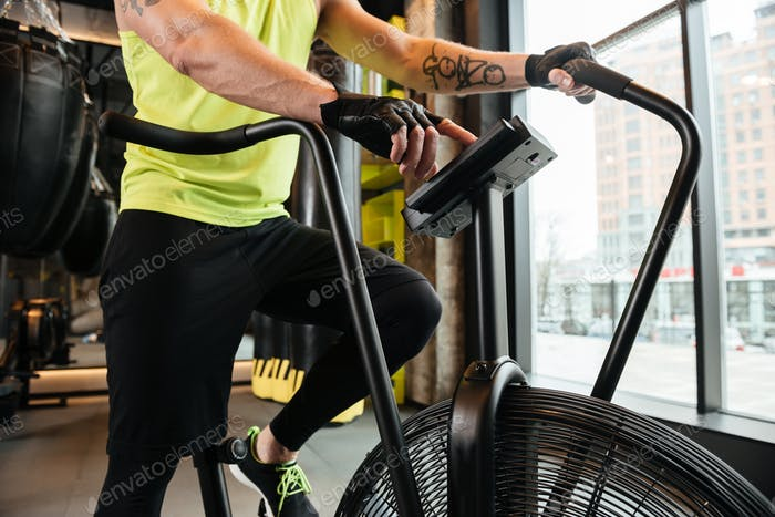 Cropped image of a muscular young sportsman doing cardio exercises