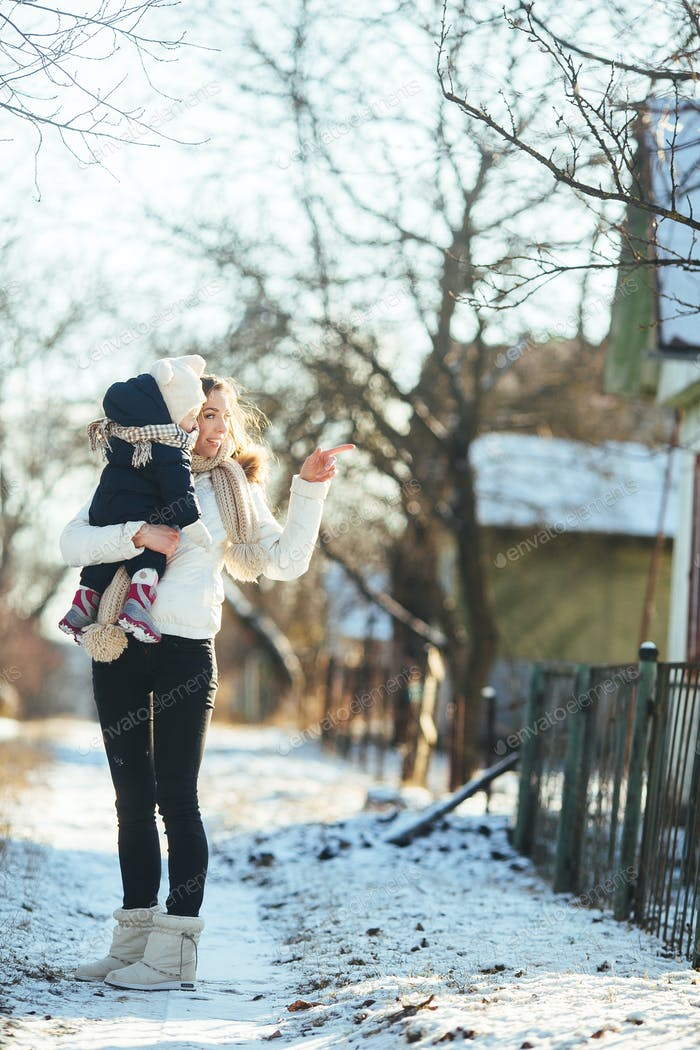 mother and daughter in the snowy countryside