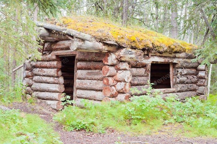 Old traditional Yukon log house rotting Canada
