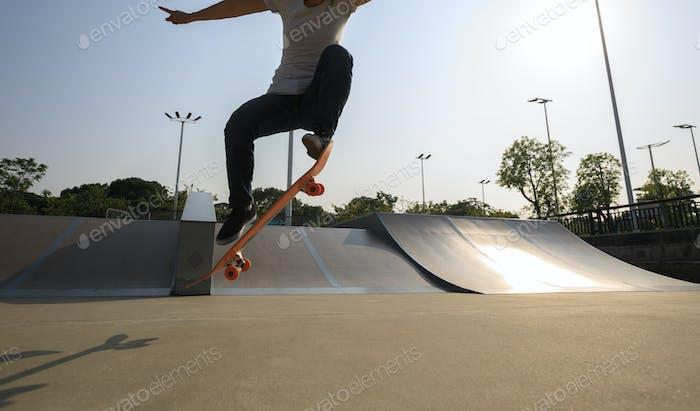 woman skateboarding at skatepark