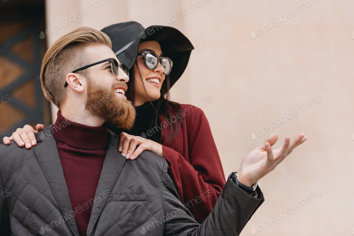 young beautiful couple looking away outdoors