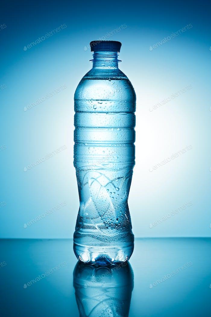 Blue plastic bottle with drops