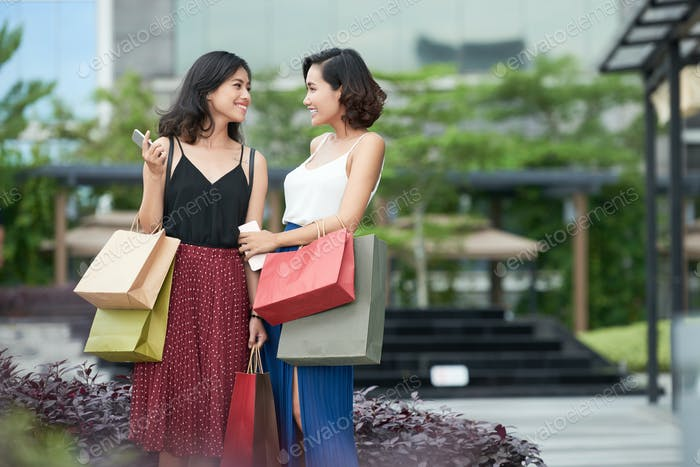 Pretty Women Discussing Purchase