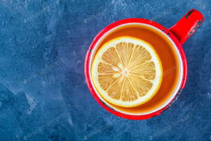 red cup of tea with slice of lemon