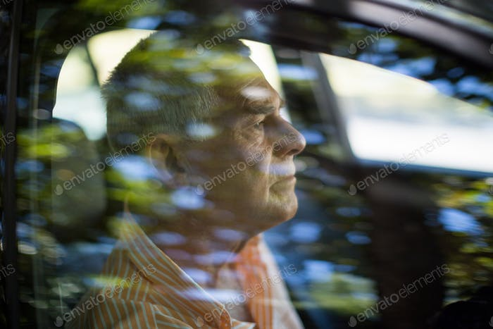 Man seen through car window