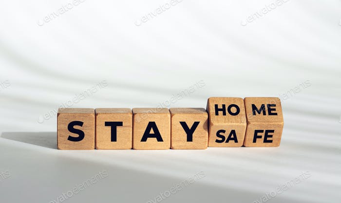 Stay at home stay safe message on wooden blocks