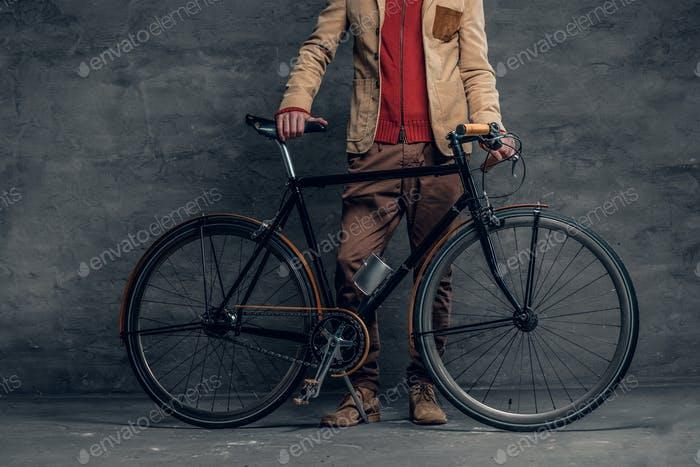 A man posing with single speed bicycle