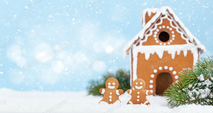 Christmas greeting card with gingerbread house