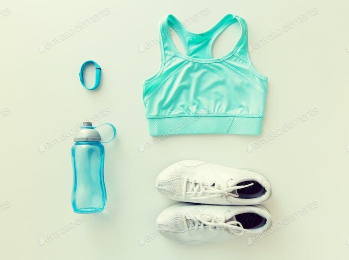 close up of sportswear, bracelet and bottle