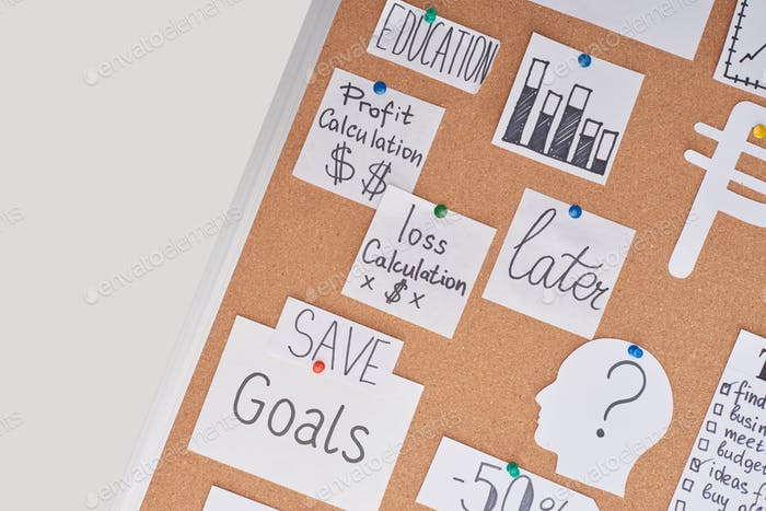 Top View of Cards With Financial Notes And Charts Pinned on Office Cork Board