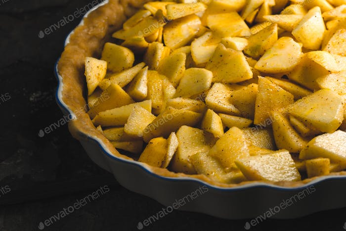 Raw apple pie to prepare for Thanksgiving day side view