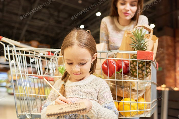 Little Girl Grocery Shopping with Mom