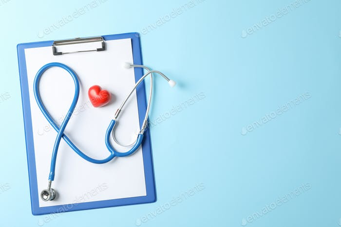 Stethoscope and heart on blue background, space for text