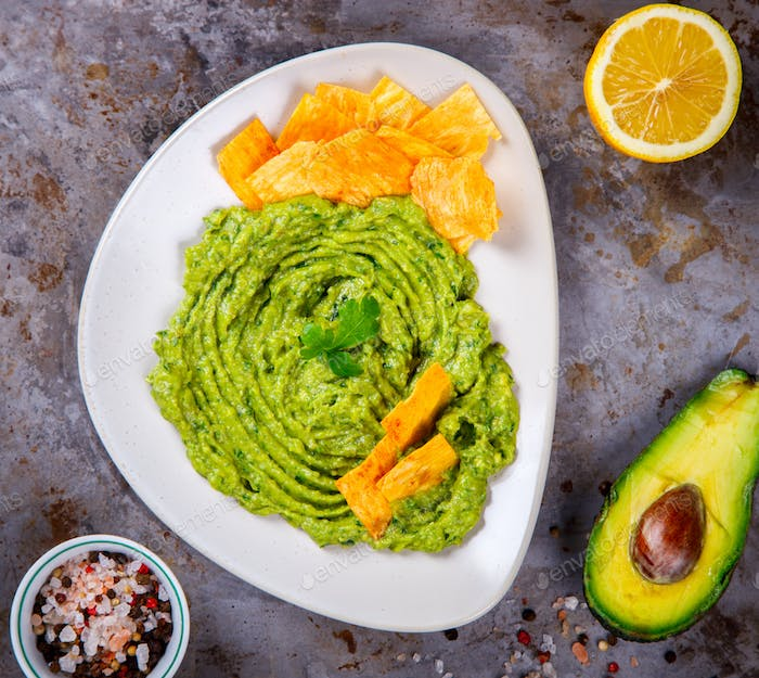 Avocado, Vegetable.Guacamole is a Traditional Mexican Sauce with Nachos.