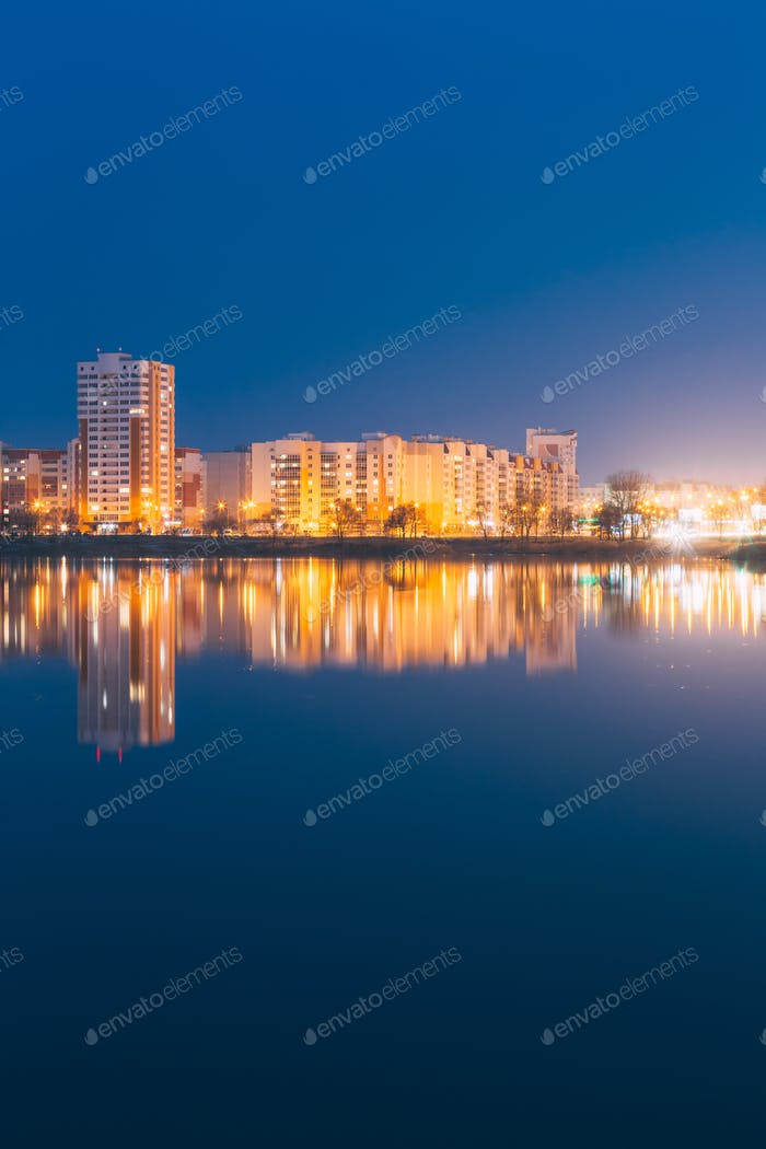 Night View Of Urban Residential Area Overlooks To City Lake Or R