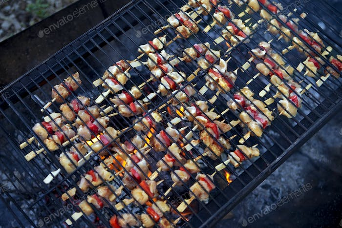 Chicken skewers on a barbecue