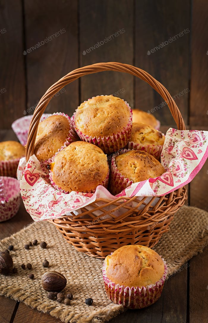 Fruit muffins with nutmeg and allspice on a wooden background