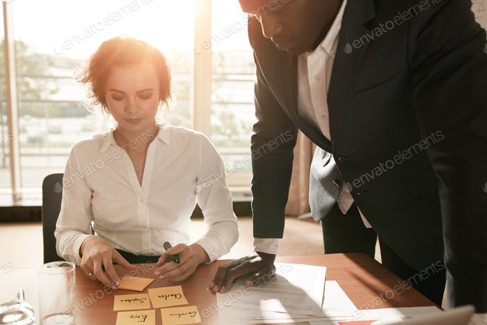 Business colleagues in conference room discussing working plan