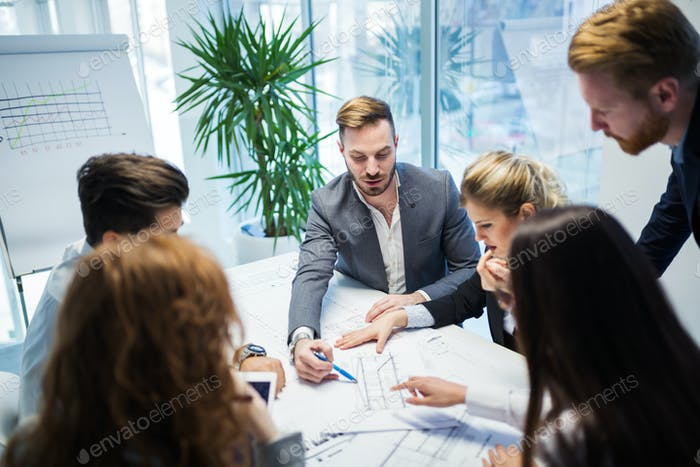 Group of architects working on business meeting