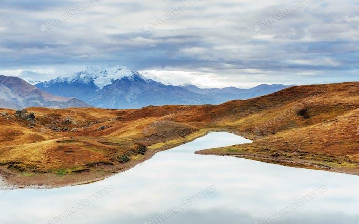 Snowy autumn mountain ridges