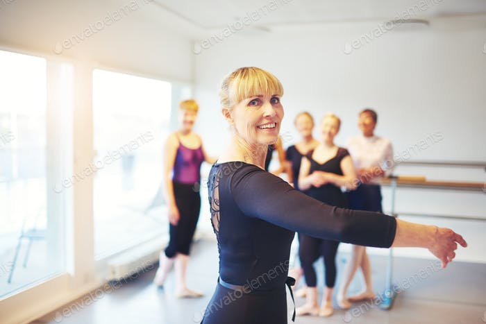 Senior woman practicing ballet in a dance studio