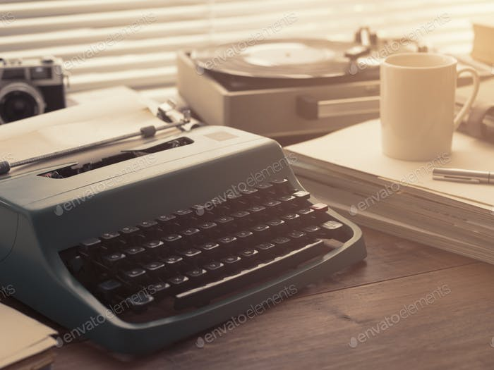 Writer and journalist vintage desktop with typewriter