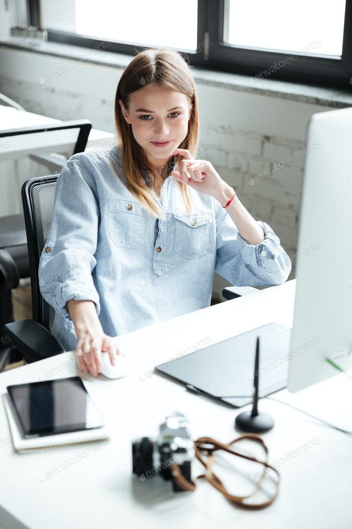 Pretty young woman work in office using computer