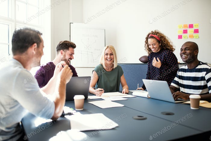 Smiling group of designers working together in an office