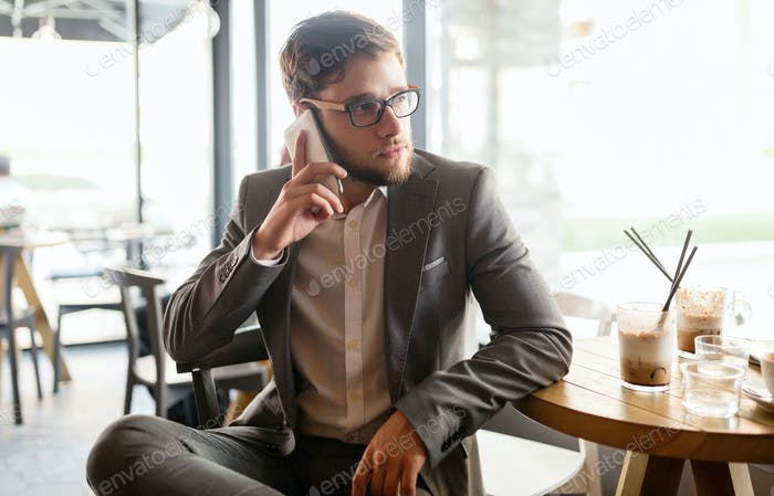 Businessman wearing glasses talking on phone