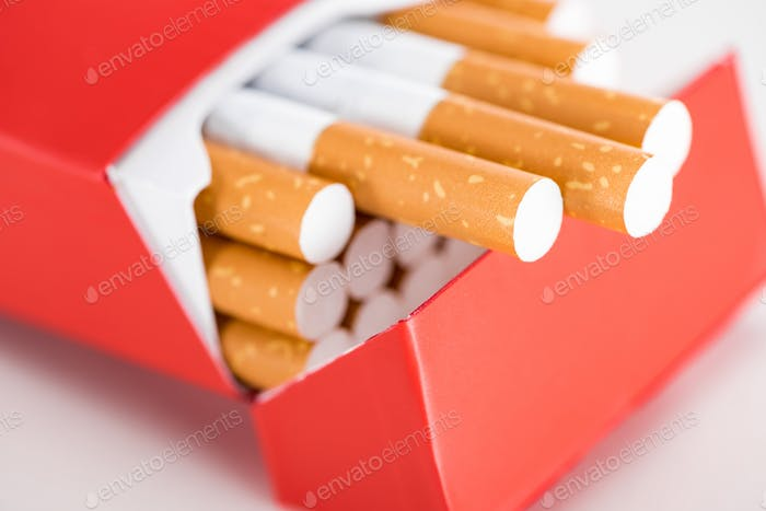 Close up shot of cigarettes in red pack